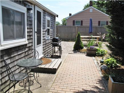Provincetown Cape Cod vacation rental - The front garden area has a gas grill and picnic table.