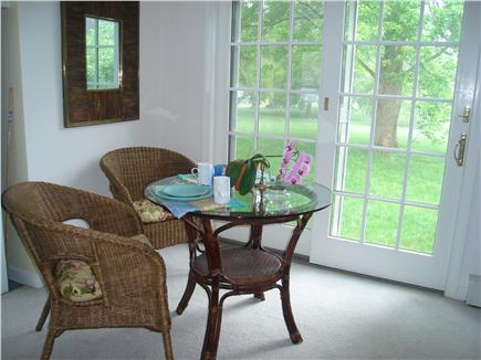East Orleans Cape Cod vacation rental - Cottage dining nook looking out to back lawn