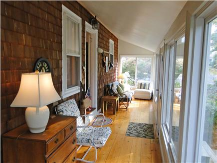 West Dennis Cape Cod vacation rental - Large sun porch w/ plenty of seating, overlooks conservation land