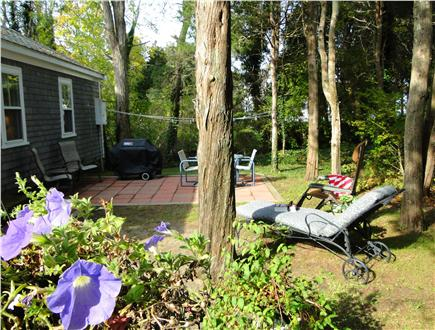 West Dennis Cape Cod vacation rental - Backyard with seating, grill, flowering gardens