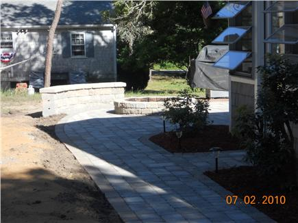 West Yarmouth Cape Cod vacation rental - Walkway to Patio, Firepit and Seating Wall