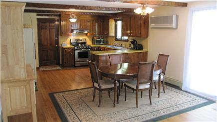Barnstable Cape Cod vacation rental - Large Open Kitchen and dining area with a/c and sliders to Deck