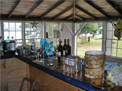 Dennis Village, Scargo Lake Cape Cod vacation rental - Interior of separate lakefront boathouse full bar & stools