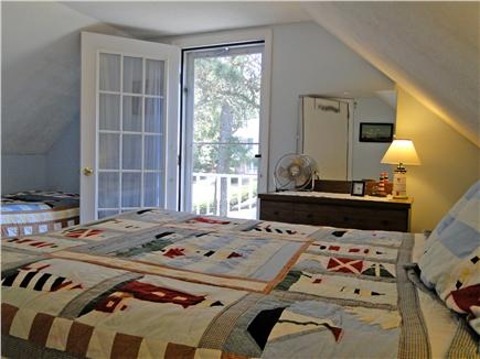 Harwich near restaurants, shopping, and deep sea fishing, also located near ferry to Nantucket Cape Cod vacation rental - Master bedroom with queen, twin and lovely deck