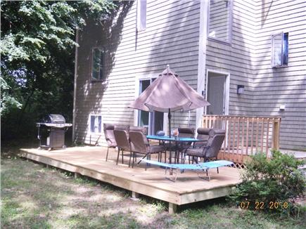 East Sandwich- West Barnstable Cape Cod vacation rental - Back yard deck BBQ and outdoor dining