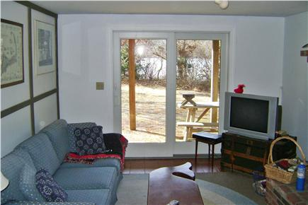 Brewster Cape Cod vacation rental - Family rec style room with TV, DVD and slider out to backyard