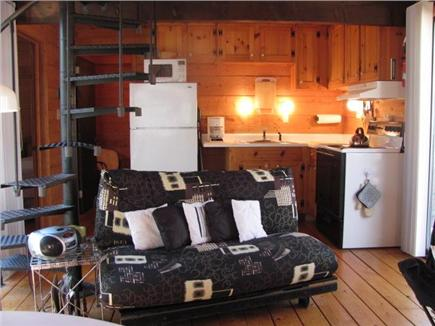 South Wellfleet Cape Cod vacation rental - Functional kitchen, living room futon, stairs to loft bedroom.