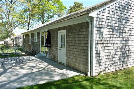 South Yarmouth Cape Cod vacation rental - Patio - picnic table, grill, 2 patio sets, 2 pers swing w/canopy