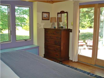 Brewster Cape Cod vacation rental - Master bedroom with beautiful views to pond and patio