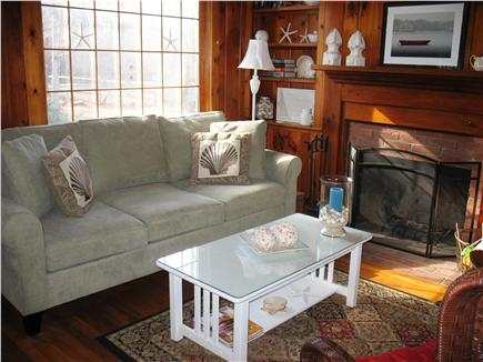 Eastham Cape Cod vacation rental - Sunfilled  living room with fireplace and classic knotty pine