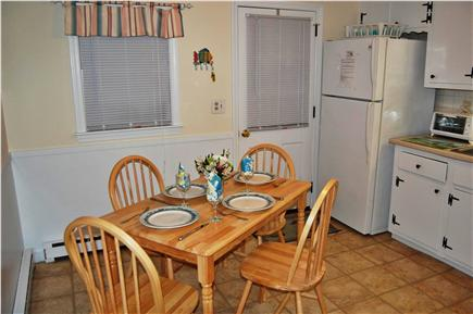 South Yarmouth Cape Cod vacation rental - Door from the kitchen leads to side and back yard