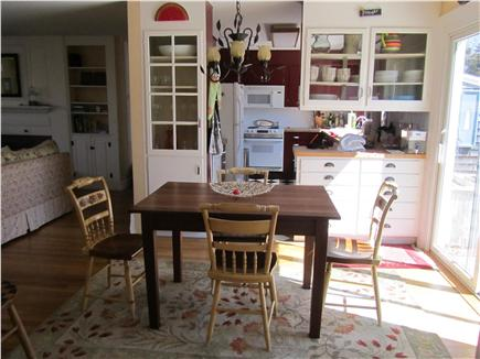 Eastham Cape Cod vacation rental - Brkfst. table outside kitchen; sliding door opens to large dec.