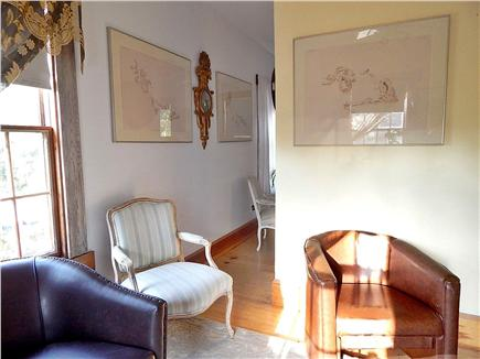 N. Truro Cape Cod vacation rental - Living room seating area, chairs, and passway to bedroom
