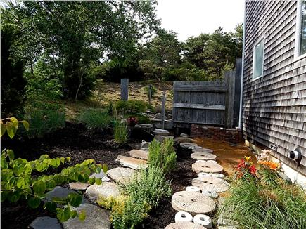 No. Truro Cape Cod vacation rental - A millstone pathway runs beside the house to Apt. 20128 patio
