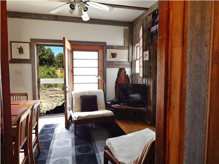 No. Truro Cape Cod vacation rental - Living room with open door, cable TV, futons, and dining table