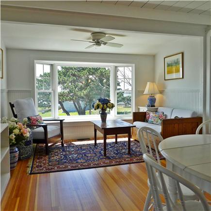 West Yarmouth Cape Cod vacation rental - The dining area opens onto another sitting area.
