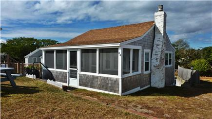 Dennisport Cape Cod vacation rental - Enjoy sweeping ocean views from the cottage's porch and lawn