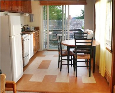 Woods Hole Woods Hole vacation rental - 2nd floor living room and kitchen/dining area. 2 picture windows.