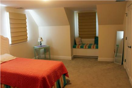 Mashpee Cape Cod vacation rental - Large bedroom upstairs with a window seat in the dormer