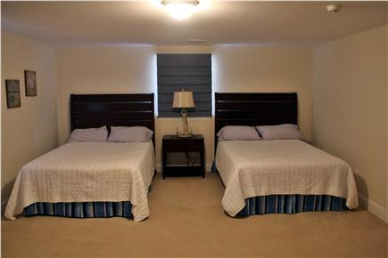 Mashpee Cape Cod vacation rental - rge bedroom upstairs with a window seat in the dormer