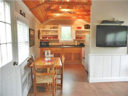 Wellfleet Cape Cod vacation rental - Dining area into kitchen ~ 40 inch LCD TV & DVD player
