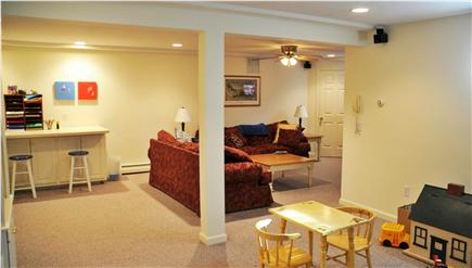 Dennis Village Cape Cod vacation rental - Spacious, carpeted basement playroom with art center, TV, and DVD