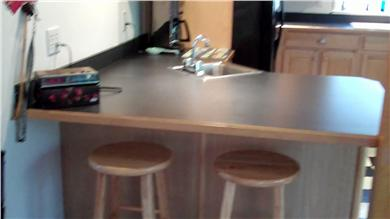 Mashpee Cape Cod vacation rental - Left side of kitchen with eat in counter area