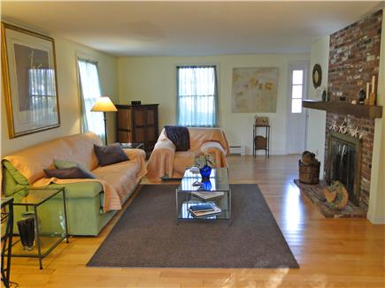 Chatham Cape Cod vacation rental - Spacious living room with fireplace and slider to back yard