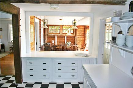 Harwich Port Cape Cod vacation rental - Kitchen to separate eating area with table and counter seating