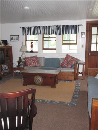 Eastham Cape Cod vacation rental - Living room, door to enclosed porch with ceiling fan