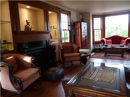 West Falmouth Cape Cod vacation rental - Front to back living room with views of patio and water