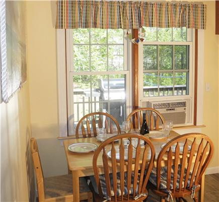 Eastham Cape Cod vacation rental - Kitchen overlooks deck and sunny back yard