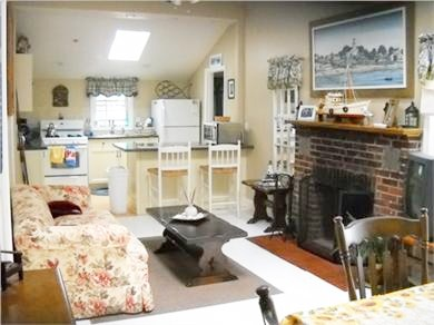 Onset, Buzzards Bay MA vacation rental - living room with wood burning fireplace