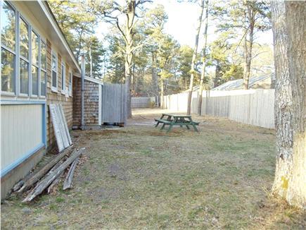 Dennis Port Cape Cod vacation rental - Partially fenced back yard