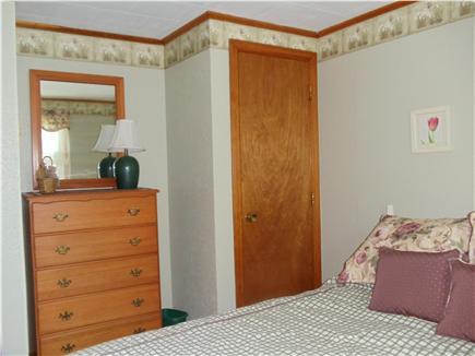 Dennis Port Cape Cod vacation rental - Master bedroom shows bureau, closet arrangement for all bedrooms