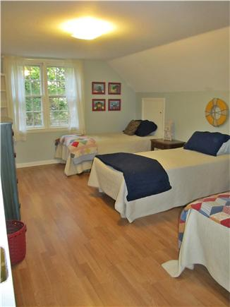 Harwichport Cape Cod vacation rental - Second floor bedroom with three beds and washer dryer closet.