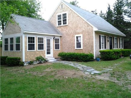 Harwichport Cape Cod vacation rental - Exterior of home with large yard..plenty of parking.