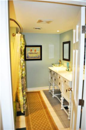 South Yarmouth Cape Cod vacation rental - Main bath with antique, double-sink buffet