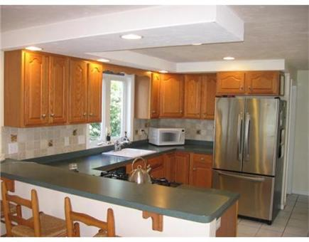 Sandwich Cape Cod vacation rental - Spacious kitchen, modern appliances, breakfast counter stools