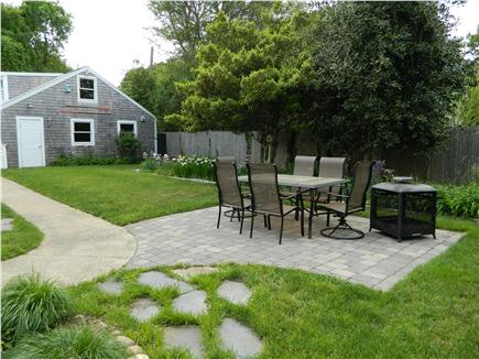 Hyannis Cape Cod vacation rental - Back yard, new patio and fire pit with garage in the background