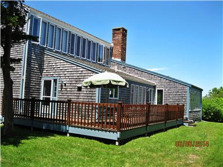 East Sandwich Cape Cod vacation rental - Front deck with dining and sitting areas.