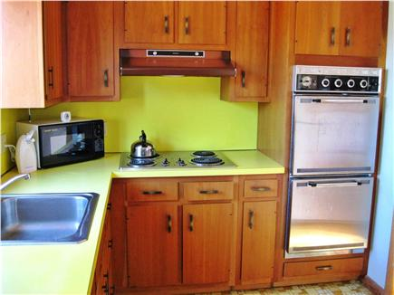 East Sandwich Cape Cod vacation rental - Kitchen with refrigerator opposite the oven.