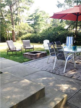 South Yarmouth Cape Cod vacation rental - Backyard with patio and fire pit