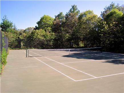 Dennis Cape Cod vacation rental - Neighborhood Tennis Court abuts property.