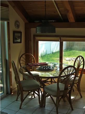 Plymouth, Manomet MA vacation rental - Dining area Sunroom - view to private backyard & flower garden