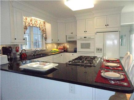 Eastham Cape Cod vacation rental - Gourmet kitchen with granite counters and breakfast bar seating