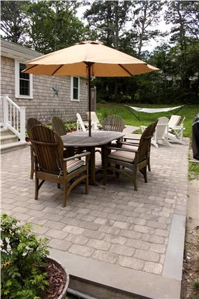 Harwich, Pleasant Lake Cape Cod vacation rental - Teak Dining Set and Steamer Lounges, and Adirondack Chairs