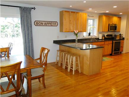 Wellfleet Cape Cod vacation rental - Kitchen area opens to dining are, sliders to deck