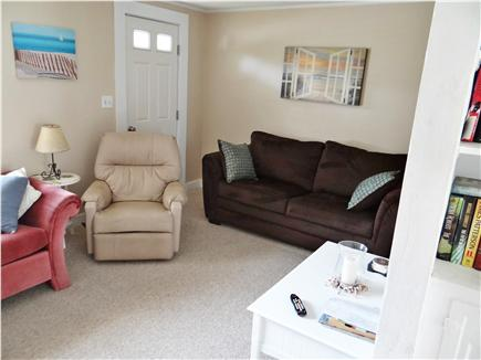 South Yarmouth Cape Cod vacation rental - Living room with sleeper sofa, bookshelf & recliner