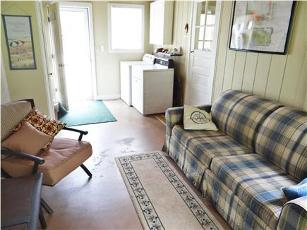 South Yarmouth Cape Cod vacation rental - Washer/dryer in breezeway with full size sleeper sofa & t.v.